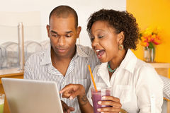couple-dining-out-using-laptop-14885834